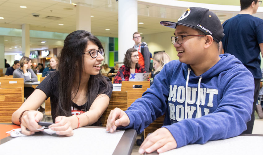 Jessy Aulakh and Jonathan Galang are part of the hubbub in the on-campus food court in Wyckham House.