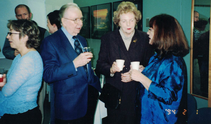 Gerry and Margaret Law chat with program administrator Valerie Parish.