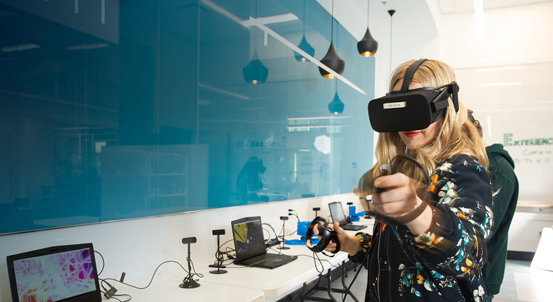 A female wearing a headset, engaged in a virtual reality session.