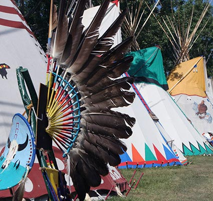 Row of colourful tipis.