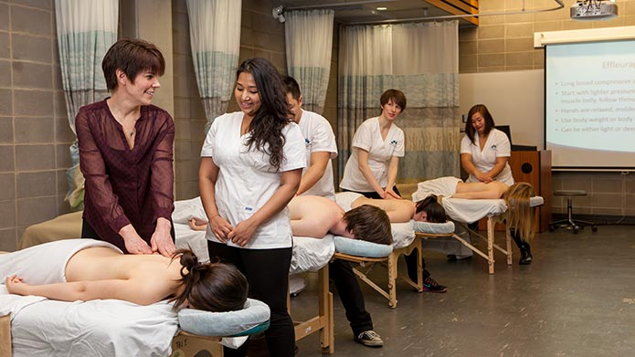 An instructor teaching a student in the Mount Royal Massage Therapy clinic.