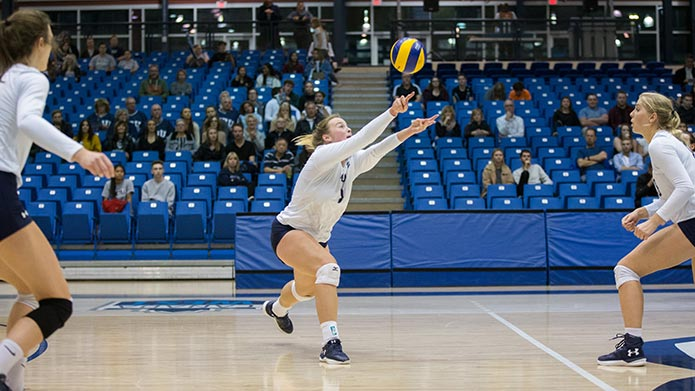 A play from a Cougars women's volleyball team