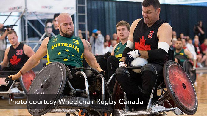 Two athletes competing in a wheelchair rugby game.