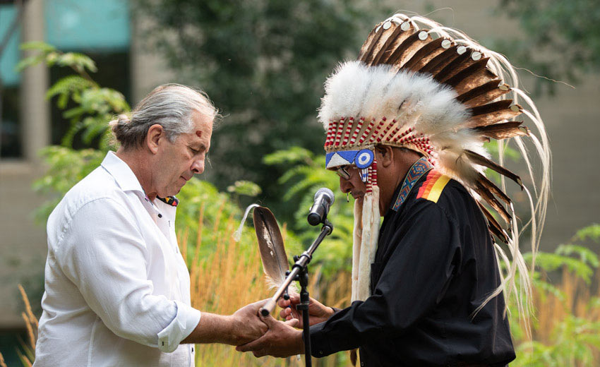 Bret Hart being gifted a traditional Blackfoot name by Siksika Nation and Elder, Clarence Wolfleg Senior (Elder Miiksika'am).